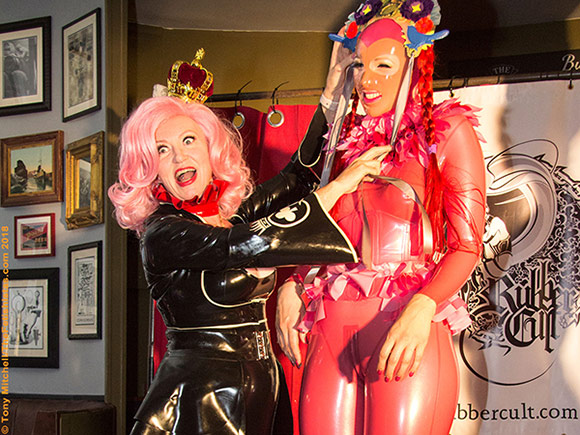 Final Rubber Cult: host Kim (left) hands out a prize