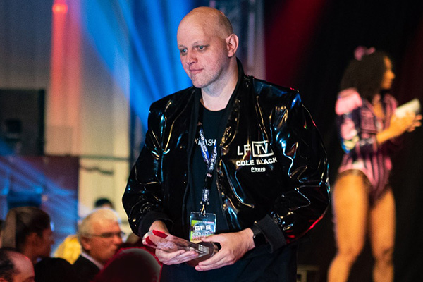 Head of LatexFashionTV Cole Black just after receiving his Special European Fetish Award at the 2019 German Fetish Ball (photo: Heinrich v Schimmer)