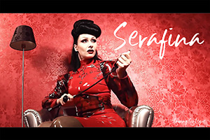 SERAFINA: in the first of the Sinteque videos by Mark Esper, she plays a madame in Brigitte More red latex whose house guest steals her time and attention
